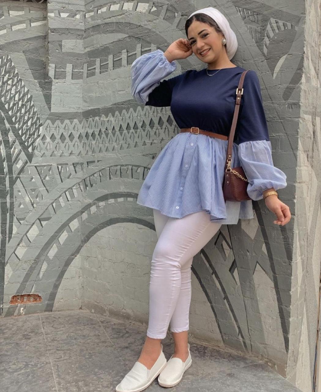 4 نوران خليفة بالتونيك المصمم بدرجات اللون الازرق -الصورة من حسابها على الانستغرا